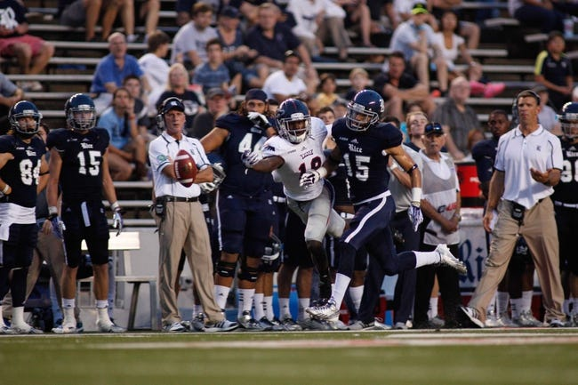 Sep 28, 2013; Houston, TX, USA; Florida Atlantic Owls wide receiver William Dukes (19) can't catch the pass against Rice Owls cornerback Phillip Gaines (15) during the second quarter at Rice Stadium. Mandatory Credit: Andrew Richardson-USA TODAY Sports