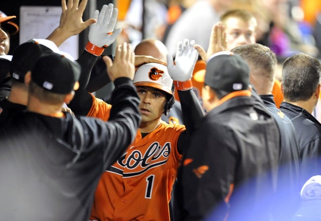 Sep 28, 2013; Baltimore, MD, USA; Baltimore Orioles second baseman Brian Roberts (1) is congratulated by teammates after hitting a solo home run in the third inning against the Boston Red Sox at Oriole Park at Camden Yards. Mandatory Credit: Joy R. Absalon-USA TODAY Sports