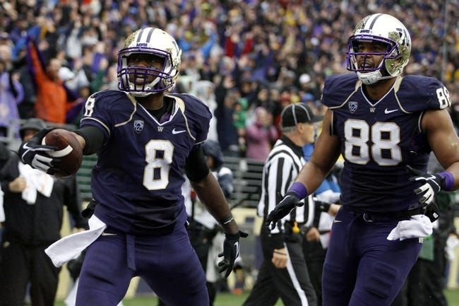 Sep 28, 2013; Seattle, WA, USA; Washington Huskies wide receiver Kevin Smith (8) celebrates a touchdown reception against the Arizona Wildcats with tight end Austin Seferian-Jenkins (88) during the first quarter at Husky Stadium. Mandatory Credit: Joe Nicholson-USA TODAY Sports