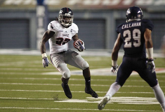 Sep 28, 2013; Houston, TX, USA; Florida Atlantic Owls running back Jonathan Wallace (27) carries the ball against the Rice Owls during the second quarter at Rice Stadium. Mandatory Credit: Andrew Richardson-USA TODAY Sports