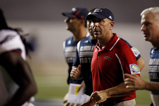 Sep 28, 2013; Houston, TX, USA; Florida Atlantic Owls head coach Carl Pelini walks off the field during halftime against the Rice Owls at Rice Stadium. Mandatory Credit: Andrew Richardson-USA TODAY Sports