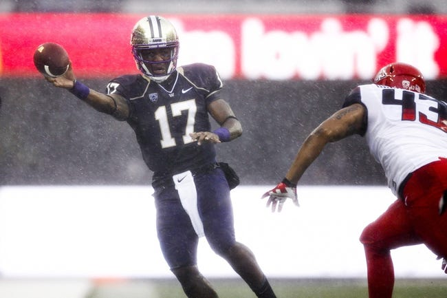 Sep 28, 2013; Seattle, WA, USA; Washington Huskies quarterback Keith Price (17) passes against the Arizona Wildcats during the first quarter at Husky Stadium. Mandatory Credit: Joe Nicholson-USA TODAY Sports