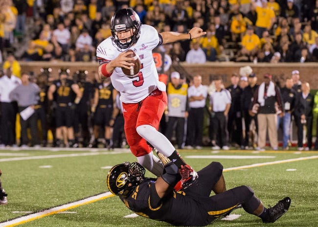 Sep 28, 2013; Columbia, MO, USA; Arkansas State Red Wolves quarterback Adam Kennedy (5) is sacked by Missouri Tigers defensive lineman Michael Sam (52) during the first half at Faurot Field. Mandatory Credit: Jasen Vinlove-USA TODAY Sports