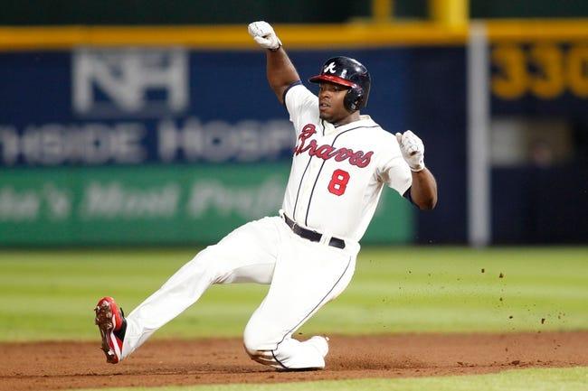 Sep 28, 2013; Atlanta, GA, USA; Atlanta Braves left fielder Justin Upton (8) slides in safely to second against the Philadelphia Phillies in the fifth inning at Turner Field. Mandatory Credit: Brett Davis-USA TODAY Sports