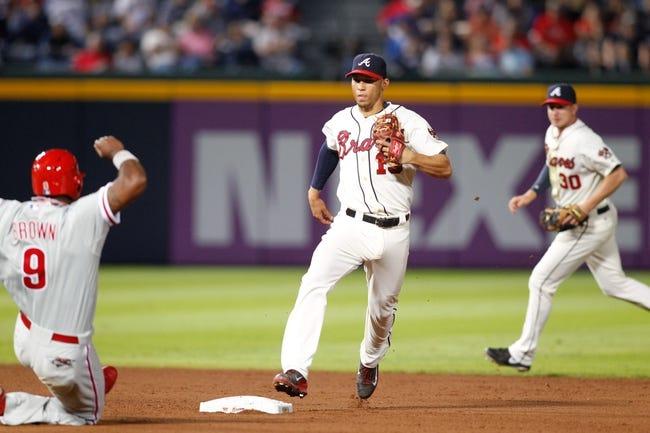 Sep 28, 2013; Atlanta, GA, USA; Atlanta Braves shortstop Andrelton Simmons (19) tags second against the Philadelphia Phillies in the seventh inning at Turner Field. Mandatory Credit: Brett Davis-USA TODAY Sports