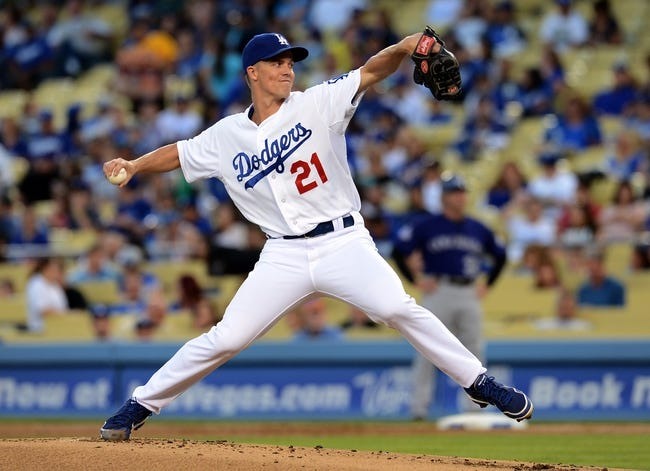 Sep 28, 2013; Los Angeles, CA, USA;   Los Angeles Dodgers starting pitcher Zack Greinke (21) in the second inning of the game against the Colorado Rockies at Dodger Stadium. Mandatory Credit: Jayne Kamin-Oncea-USA TODAY Sports