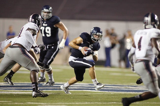 Sep 28, 2013; Houston, TX, USA; Rice Owls quarterback Taylor McHargue (16) runs with the ball during the fourth quarter at Rice Stadium. Mandatory Credit: Andrew Richardson-USA TODAY Sports
