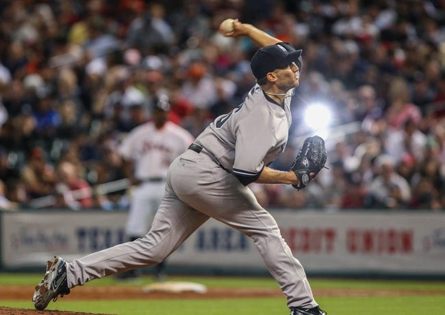 Sep 28, 2013; Houston, TX, USA; New York Yankees starting pitcher Andy Pettitte (46) pitches during the fifth inning against the Houston Astros at Minute Maid Park. Mandatory Credit: Troy Taormina-USA TODAY Sports