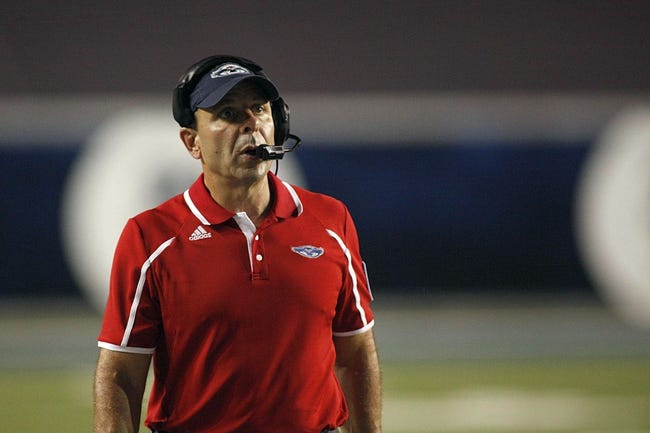 Sep 28, 2013; Houston, TX, USA; Florida Atlantic Owls head coach Carl Pelini on the sideline during the third quarter against the Rice Owls at Rice Stadium. Mandatory Credit: Andrew Richardson-USA TODAY Sports