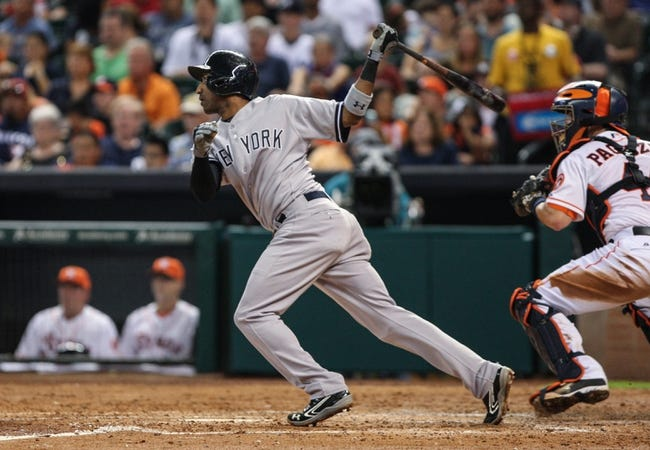 Sep 28, 2013; Houston, TX, USA; New York Yankees shortstop Eduardo Nunez (26) gets a single during the sixth inning against the Houston Astros at Minute Maid Park. Mandatory Credit: Troy Taormina-USA TODAY Sports