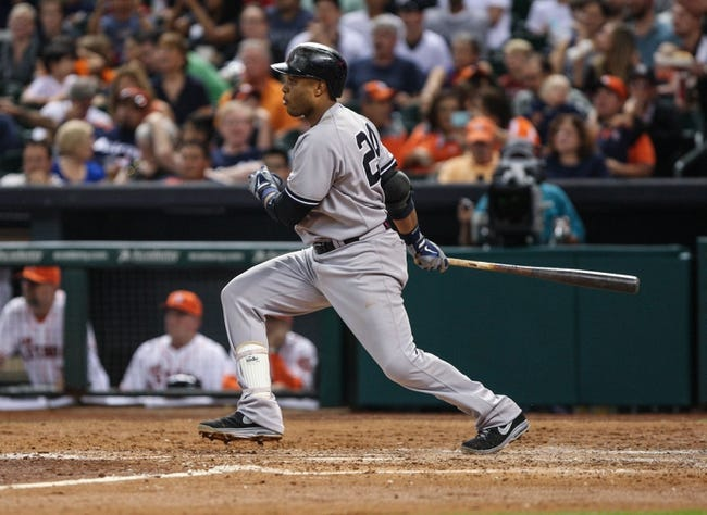 Sep 28, 2013; Houston, TX, USA; New York Yankees second baseman Robinson Cano (24) gets a hit during the sixth inning against the Houston Astros at Minute Maid Park. Mandatory Credit: Troy Taormina-USA TODAY Sports