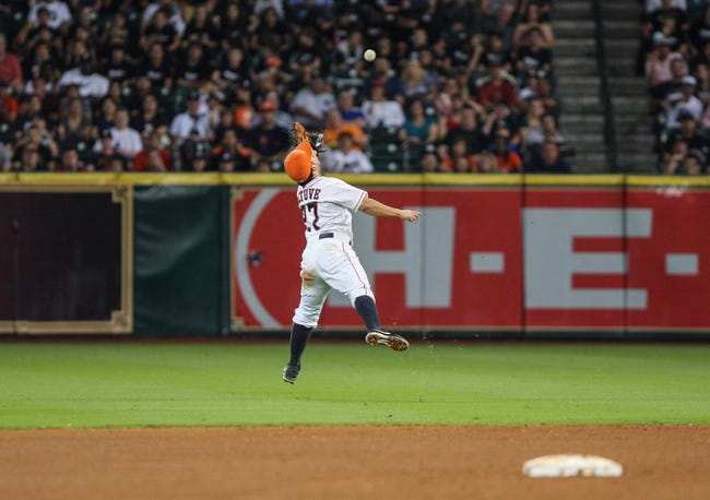 Sep 28, 2013; Houston, TX, USA; Houston Astros second baseman Jose Altuve (27) attempts to catch a ball during the seventh inning against the New York Yankees at Minute Maid Park. Mandatory Credit: Troy Taormina-USA TODAY Sports