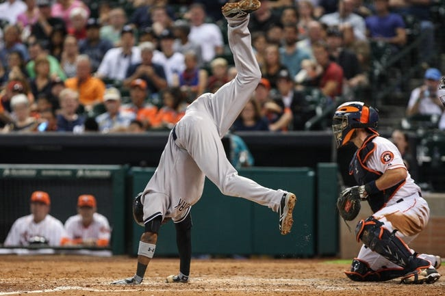 Sep 28, 2013; Houston, TX, USA; New York Yankees shortstop Eduardo Nunez (26) moves to avoid a pitch during the sixth inning against the Houston Astros at Minute Maid Park. Mandatory Credit: Troy Taormina-USA TODAY Sports