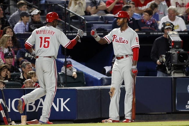 Sep 28, 2013; Atlanta, GA, USA; Philadelphia Phillies right fielder John Mayberry Jr. (15) is congratulated by left fielder Domonic Brown (9) after scoring a run against the Atlanta Braves in the eighth inning at Turner Field. The Phillies defeated the Braves 5-4. Mandatory Credit: Brett Davis-USA TODAY Sports