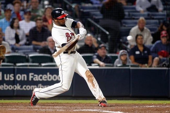Sep 28, 2013; Atlanta, GA, USA; Atlanta Braves left fielder Justin Upton (8) hits a home run against the Philadelphia Phillies in the ninth inning at Turner Field. The Phillies defeated the Braves 5-4. Mandatory Credit: Brett Davis-USA TODAY Sports