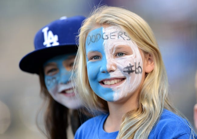Sep 28, 2013; Los Angeles, CA, USA;  Daryn Seigel and Drew Biernot, both 10, from Los Angeles hope for an autograph before the game between the Los Angeles Dodgers and the Colorado Rockies at Dodger Stadium. Mandatory Credit: Jayne Kamin-Oncea-USA TODAY Sports