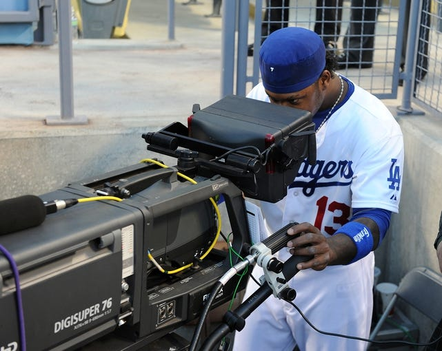 Sep 28, 2013; Los Angeles, CA, USA;  Los Angeles Dodgers shortstop Hanley Ramirez (13) checks out the TV camera before the game against the Colorado Rockies at Dodger Stadium. Mandatory Credit: Jayne Kamin-Oncea-USA TODAY Sports