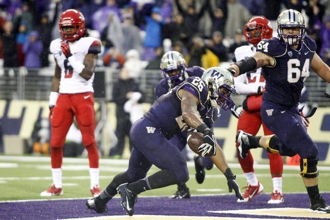Sep 28, 2013; Seattle, WA, USA; Washington Huskies running back Bishop Sankey (25) rushes for a touchdown against the Arizona Wildcats during the third quarter at Husky Stadium. Mandatory Credit: Joe Nicholson-USA TODAY Sports