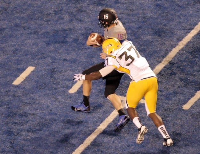 Sep 28, 2013; Boise, ID, USA; Southern Miss Golden Eagles linebacker Alan Howze (37) sacks Boise State Broncos quarterback Joe Southwick (16) during the first half against the Boise State Broncos at Bronco Stadium. Mandatory Credit: Brian Losness-USA TODAY Sports