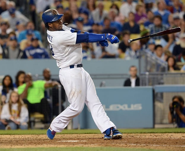 Sep 28, 2013; Los Angeles, CA, USA;  Los Angeles Dodgers shortstop Hanley Ramirez (13) lost his grip on his bat in the sixth inning of the game against the Colorado Rockies at Dodger Stadium. The bat flew into the stands injuring a woman who left the game. Mandatory Credit: Jayne Kamin-Oncea-USA TODAY Sports