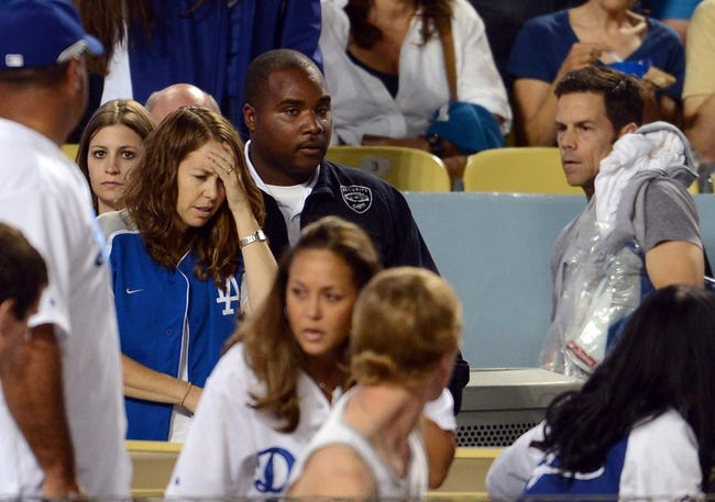 Sep 28, 2013; Los Angeles, CA, USA;  The bat of Los Angeles Dodgers shortstop Hanley Ramirez (13) sailed into the crowd in the sixth inning of the game against the Colorado Rockies at Dodger Stadium. The bat injured a woman who left the game. Mandatory Credit: Jayne Kamin-Oncea-USA TODAY Sports