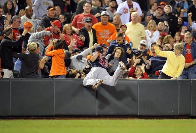 Sep 28, 2013; Baltimore, MD, USA; Boston Red Sox third baseman Will Middlebrooks (16) dives into the stands but cannot catch a foul ball hit by Baltimore Orioles designated hitter Steve Pearce (not shown) in the sixth inning at Oriole Park at Camden Yards. The Orioles defeated the Red Sox 6-5. Mandatory Credit: Joy R. Absalon-USA TODAY Sports