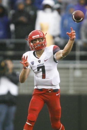 Sep 28, 2013; Seattle, WA, USA; Arizona Wildcats quarterback B.J. Denker (7) passes against the Washington Huskies during the first quarter at Husky Stadium. Mandatory Credit: Joe Nicholson-USA TODAY Sports