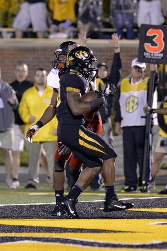 Sep 28, 2013; Columbia, MO, USA; Missouri Tigers running back Henry Josey (20) scores a touchdown during the second half against the Arkansas State Red Wolves at Faurot Field. Mandatory Credit: Jasen Vinlove-USA TODAY Sports