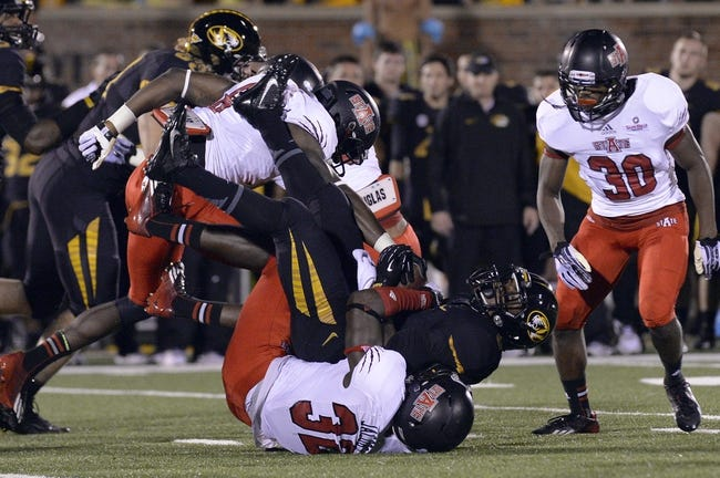 Sep 28, 2013; Columbia, MO, USA; Missouri Tigers running back Marcus Murphy (6) is tackled by Arkansas State Red Wolves defensive back Ryan Jacobs (32) during the second half at Faurot Field. Mandatory Credit: Jasen Vinlove-USA TODAY Sports