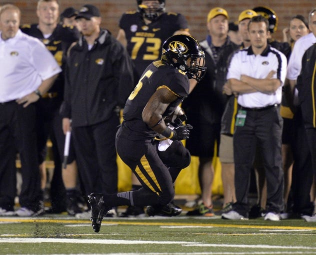 Sep 28, 2013; Columbia, MO, USA; Missouri Tigers running back Marcus Murphy (6) makes a run against the Arkansas State Red Wolves during the second half at Faurot Field. Mandatory Credit: Jasen Vinlove-USA TODAY Sports