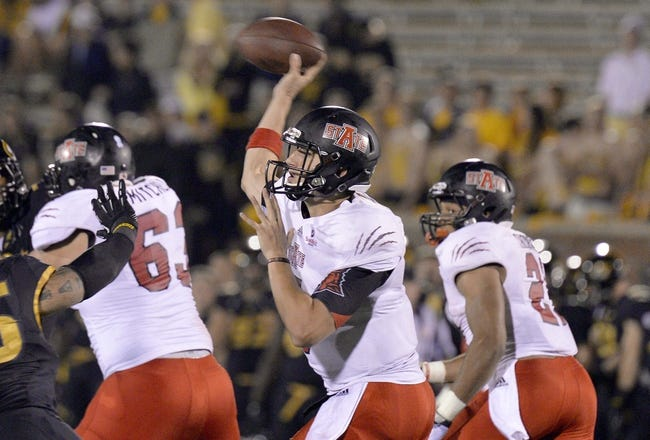 Sep 28, 2013; Columbia, MO, USA; Arkansas State Red Wolves quarterback Adam Kennedy (5) makes a pass against the Missouri Tigers during the second half at Faurot Field. Mandatory Credit: Jasen Vinlove-USA TODAY Sports