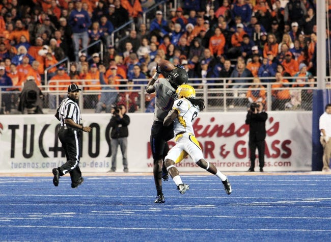 Sep 28, 2013; Boise, ID, USA; Boise State Broncos wide receiver Geraldo Boldewijn (17) catches a 52 yard pass thrown by quarterback Joe Southwick (16) during the first half against the Southern Miss Golden Eagles at Bronco Stadium. Mandatory Credit: Brian Losness-USA TODAY Sports