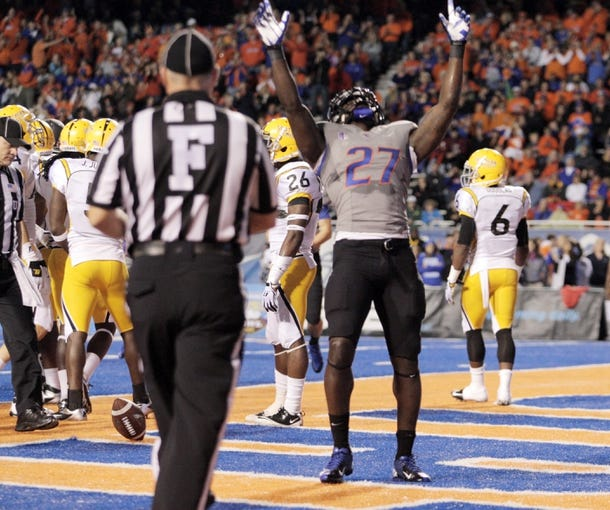Sep 28, 2013; Boise, ID, USA; Boise State Broncos running back Jay Ajayi (27) celebrates a touchdown during the first half against the Southern Miss Golden Eagles at Bronco Stadium. Mandatory Credit: Brian Losness-USA TODAY Sports