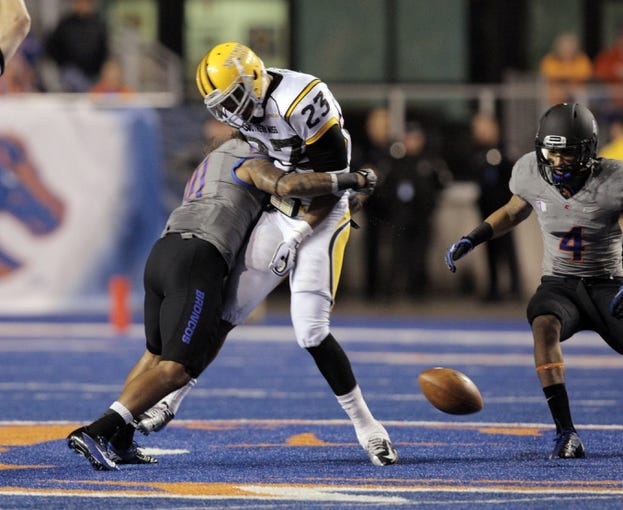 Sep 28, 2013; Boise, ID, USA; Boise State Broncos safety Jeremy Ioane (10) separates the ball from Southern Miss Golden Eagles wide receiver Markese Triplett (23) during the first half against the Southern Miss Golden Eagles at Bronco Stadium. Mandatory Credit: Brian Losness-USA TODAY Sports