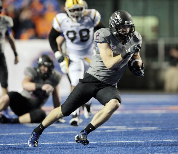 Sep 28, 2013; Boise, ID, USA; Boise State Broncos wide receiver Matt Miller (2) runs for a big gain during the first half against the Southern Miss Golden Eagles at Bronco Stadium. Mandatory Credit: Brian Losness-USA TODAY Sports