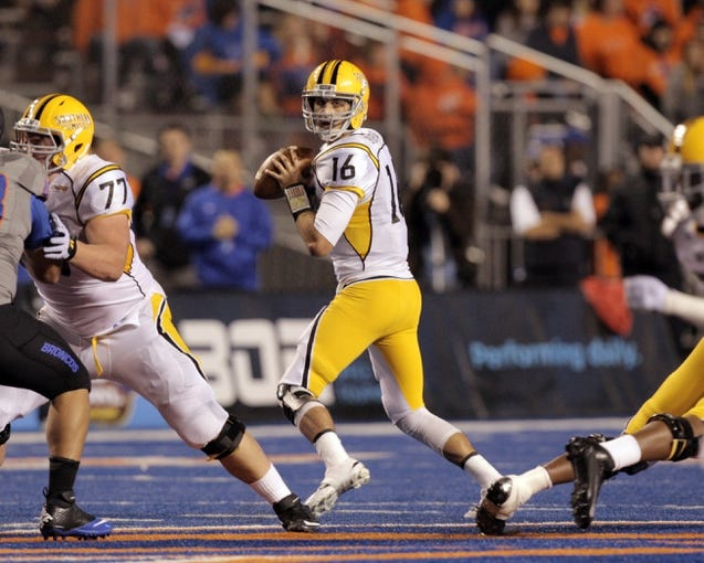 Sep 28, 2013; Boise, ID, USA; Southern Miss Golden Eagles quarterback Allan Bridgford (16) looks for an open receiver during the first half against the Boise State Broncos at Bronco Stadium. Mandatory Credit: Brian Losness-USA TODAY Sports