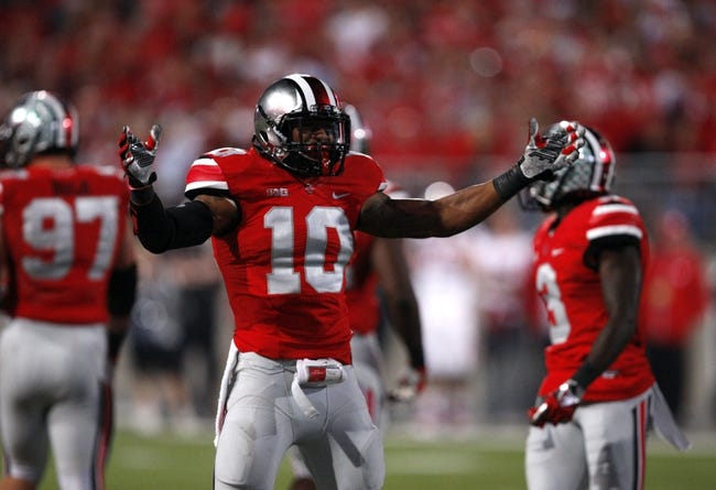 Sep 28, 2013; Columbus, OH, USA; Ohio State Buckeyes linebacker Ryan Shazier (10) pumps up the crowd during the fourth quarter against the Wisconsin Badgers at Ohio Stadium. Buckeyes beat the Badgers 31-24. Mandatory Credit: Raj Mehta-USA TODAY Sports