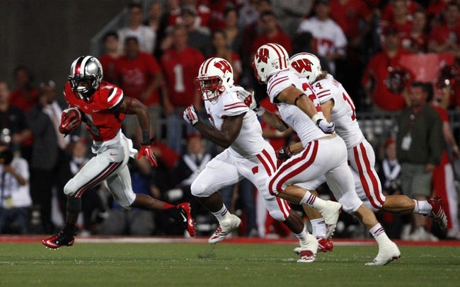 Sep 28, 2013; Columbus, OH, USA; Ohio State Buckeyes running back Dontre Wilson (1) runs with the ball during the fourth quarter against the Wisconsin Badgers at Ohio Stadium. Buckeyes beat the Badgers 31-24. Mandatory Credit: Raj Mehta-USA TODAY Sports