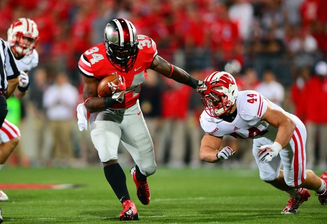 Sep 28, 2013; Columbus, OH, USA; Ohio State Buckeyes running back Carlos Hyde (34) stiff arms Wisconsin Badgers linebacker Chris Borland (44) during the first quarter at Ohio Stadium. Ohio State Buckeyes defeated Wisconsin Badgers 31-24. Mandatory Credit: Andrew Weber-USA TODAY Sports