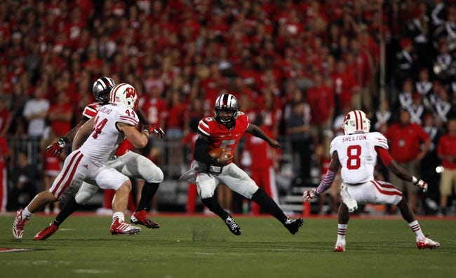 Sep 28, 2013; Columbus, OH, USA; Ohio State Buckeyes quarterback Braxton Miller (5) runs the ball against the Wisconsin Badgers during the fourth quarter at Ohio Stadium. Buckeyes beat the Badgers 31-24. Mandatory Credit: Raj Mehta-USA TODAY Sports