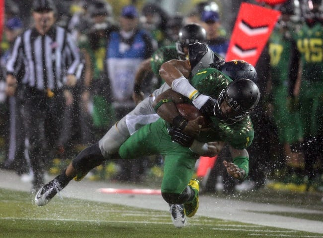 Sep 28, 2013; Eugene, OR, USA; Oregon Ducks wide receiver Josh Huff (1) is tackled by California Golden Bears defensive back Damariay Drew (27) at Autzen Stadium. Mandatory Credit: Scott Olmos-USA TODAY Sports