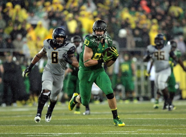 Sep 28, 2013; Eugene, OR, USA; Oregon Ducks tight end John Mundt (83) catches the ball and runs for a first down against the California Golden Bears at Autzen Stadium. Mandatory Credit: Scott Olmos-USA TODAY Sports
