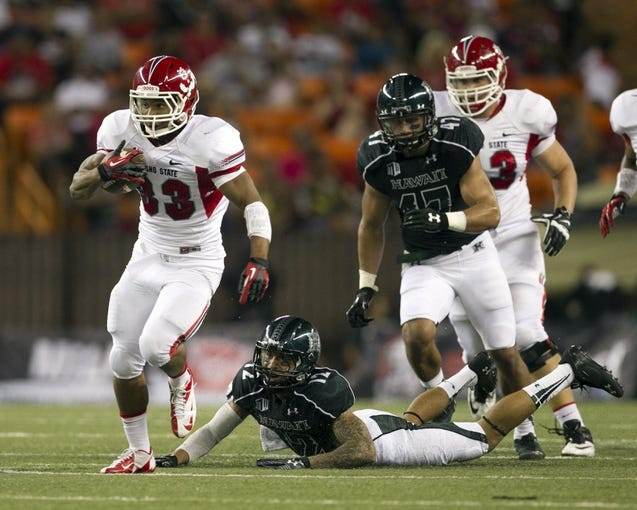 Sep 28, 2013; Honolulu, HI, USA; Fresno State running back Marteze Waller (33) breaks away from Hawaii defensive back Tony Grimes (12) during the first quarter of the NCAA college football game at Aloha Stadium. Mandatory Credit: Marco Garcia-USA TODAY Sports