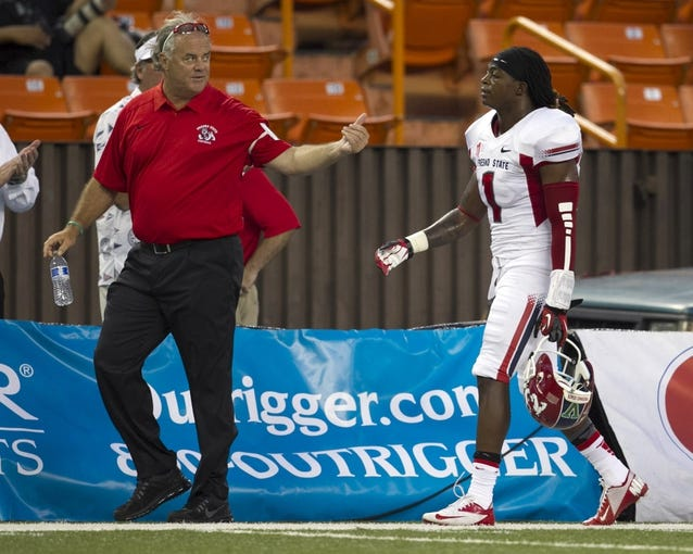 Sep 28, 2013; Honolulu, HI, USA;  Fresno State wide receiver Isaiah Burse (1) is lead away after being ejected from the game after a personal foul during the first quarter of the NCAA college football game against Hawaii at Aloha Stadium. Mandatory Credit: Marco Garcia-USA TODAY Sports