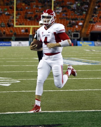 Sep 28, 2013; Honolulu, HI, USA; Fresno State quarterback Derek Carr (4) runs into the end zone for a touchdown against Hawaii during the second quarter of the NCAA college football game at Aloha Stadium. Mandatory Credit: Marco Garcia-USA TODAY Sports