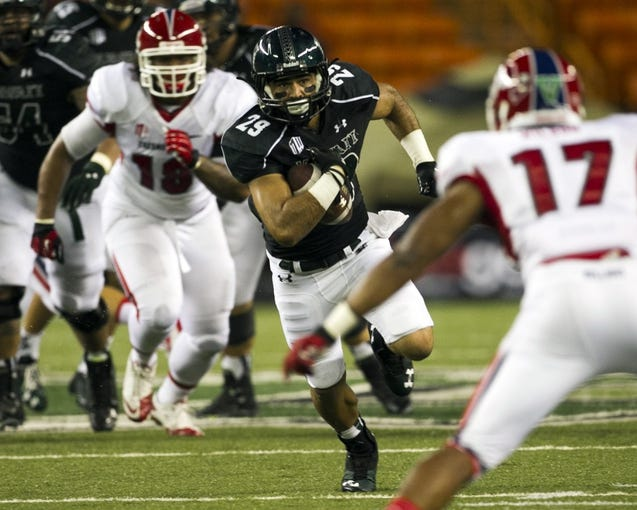 Sep 28, 2013; Honolulu, HI, USA; Hawaii wide receiver Scott Harding (29) runs through the Fresno State defense during the second quarter at Aloha Stadium. Mandatory Credit: Marco Garcia-USA TODAY Sports