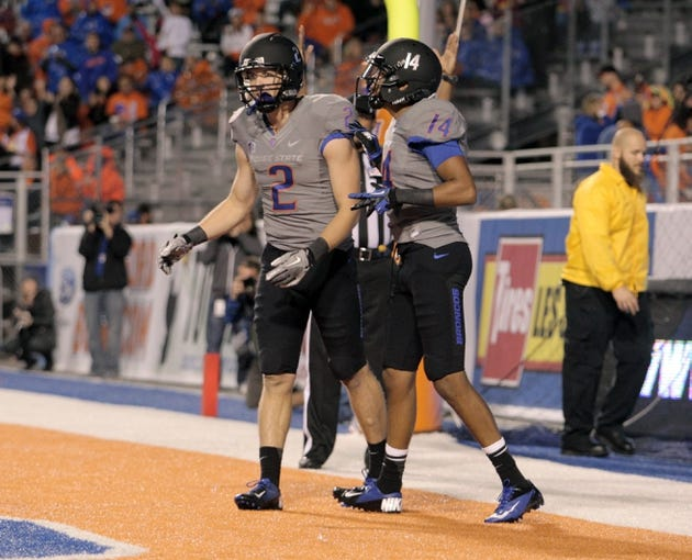 Sep 28, 2013; Boise, ID, USA; Boise State Broncos wide receiver Matt Miller (2) and wide receiver Troy Ware (14) celebrate Millers touchdown during the second half against the Southern Miss Golden Eagles at Bronco Stadium. Boise State defeated Southern Miss 60-7. Mandatory Credit: Brian Losness-USA TODAY Sports