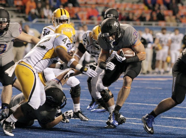 Sep 28, 2013; Boise, ID, USA; Boise State Broncos running back Charles Bertoli (35) runs down close to the goal line during the second half against the Southern Miss Golden Eagles at Bronco Stadium. Boise State defeated Southern Miss 60-7. Mandatory Credit: Brian Losness-USA TODAY Sports
