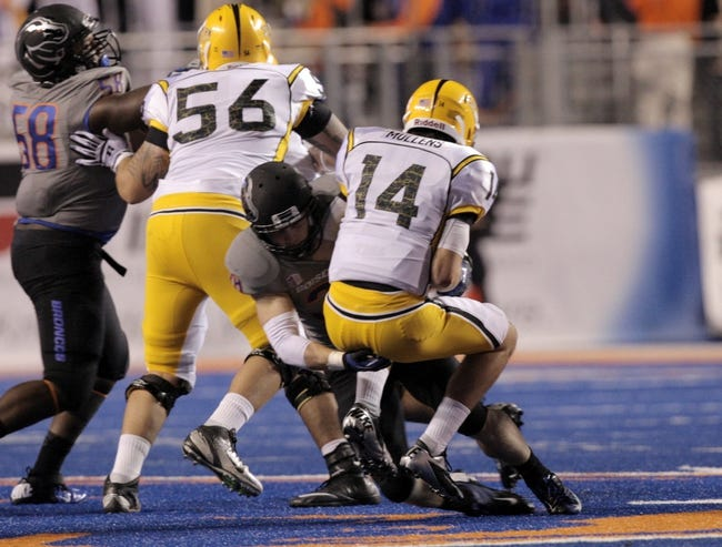 Sep 28, 2013; Boise, ID, USA; Southern Miss Golden Eagles quarterback Nick Mullens (14) is sacked by Boise State Broncos linebacker Corey Bell (38) during the second half against the Boise State Broncos at Bronco Stadium. Boise State defeated Southern Miss 60-7.  Mandatory Credit: Brian Losness-USA TODAY Sports