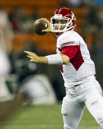 Sep 28, 2013; Honolulu, HI, USA;  Fresno State quarterback Derek Carr (4) makes a pass during the third quarter of the NCAA college football game against Hawaii at Aloha Stadium. Mandatory Credit: Marco Garcia-USA TODAY Sports